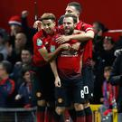 Manchester United's Juan Mata (centre) celebrates the opening goal against Derby.