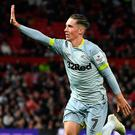 Harry Wilson, on loan at Derby from Liverpool, celebrates at Old Trafford.