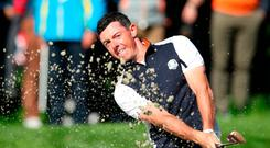 Knows the score: Rory McIlroy believes Europe must focus on defeating the whole United States team at Le Golf National