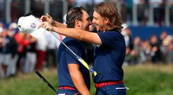 Francesco Molinari and Tommy Fleetwood gave Team Europe hope in the Friday morning session at Le Golf National.