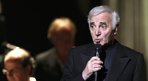 Charles Aznavour, a French singer of Armenian origin, performs during a concert in Marseille (Claude Paris/AP)
