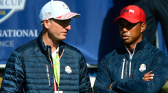 Gone wrong: US skipper Jim Furyk speaks with Tiger Woods at the Ryder Cup