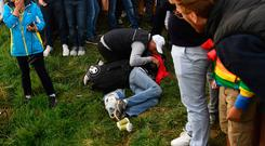 An injured spectator is attended to after being struck by a wayward drive at the Ryder Cup.