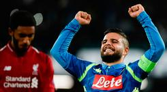 Late show: Napoli ace Lorenzo Insigne celebrates after striking in the final minute to condemn Liverpool to Champions League defeat