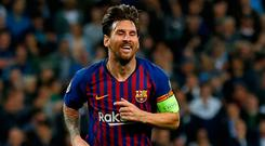 Smiles better: Lionel Messi celebrates after carving open Spurs