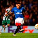 Spot on: James Tavernier slots home a penalty to put Rangers 2-1 ahead while