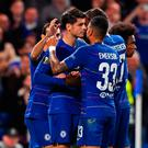 On target: Alvaro Morata is mobbed after netting winner