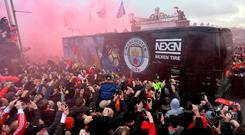 Sorry sight: Manchester City's team bus comes under fire from Liverpool fans in April
