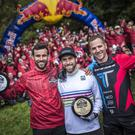 (L-R) Killian Bron of France, Colin Ross of Ireland and Glyn O´Brian of the United Kingdom celebrate at the Red Bull Foxhunt in Rostrevor, Northern Ireland on October 7, 2018.