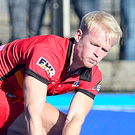 Derby clash: Banbridge's Peter Brown (right) whips in a cross during the nine-goal thriller against Lisnagarvey in the EY Irish Hockey League at Hillsborough