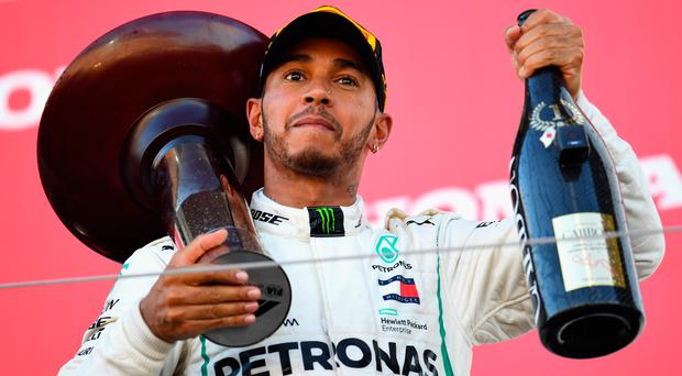 Champagne moment: Lewis Hamilton is closing in on title