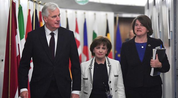 European Union Chief Brexit negotiator Michel Barnier, left, arrives with Northern Ireland Democratic Unionist Party leader Arlene Foster, right, and DUP European Parliament member Diane Dodds for their meeting at the European Commission headquarters in Brussels, Tuesday, Oct. 9, 2018. (Emmanuel Dunand, Pool Photo, Via AP)