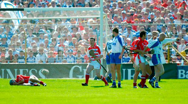 Lashing out: John Mullane of Waterford is restrained by Sean Og O'hAilpin after he struck Brian Murphy back in 2004