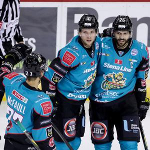 Belfast Giants' Curtis Leonard (centre) celebrates scoring