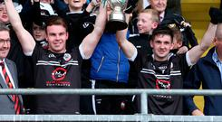 Joy of six: Kilcoo's Darragh O'Hanlon and Darryl Branagan lift the Down Senior Football trophy last season
