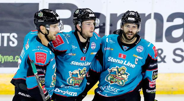 Ice cool: Belfast Giants ace Curtis Leonard (centre) celebrates scoring against the Guildford Flames last night