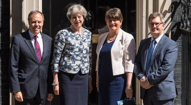 Happier times: Prime Minister Theresa May greets DUP leader Arlene Foster, DUP deputy leader Nigel Dodds and DUP MP Sir Jeffrey Donaldson outside 10 Downing Street (Dominic Lipinski/PA)