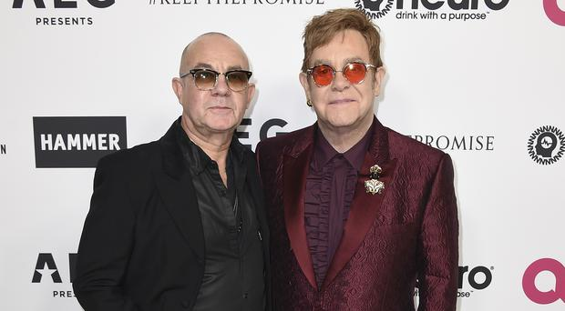 Sir Elton John and Bernie Taupin worked together on Your Song (Jordan Strauss/Invision/AP)