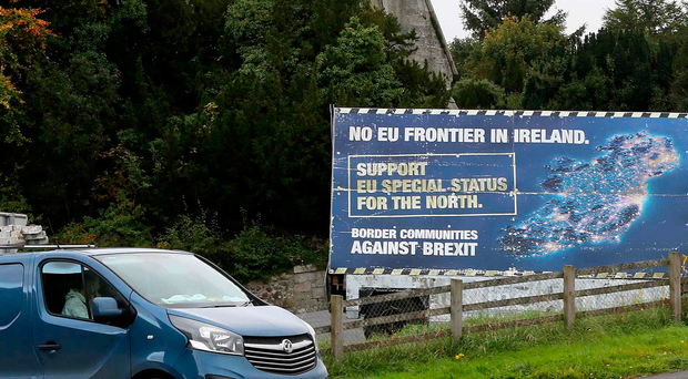 A public sign against Brexit situated by the road
