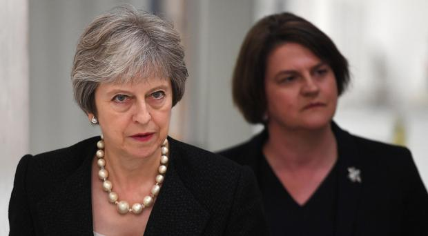 Prime Minister Theresa May, left, and DUP leader Arlene Foster (PA)