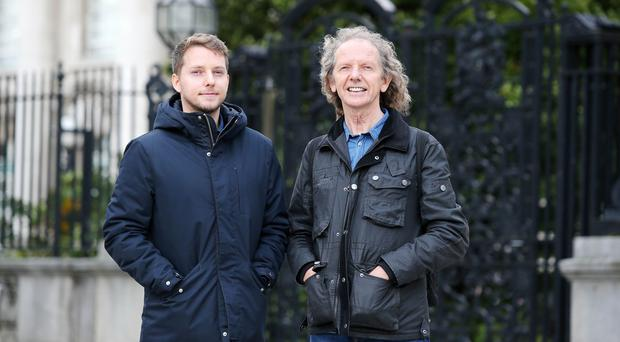 Folk singer Colum Sands with his son Dara pictured outside the High Court in Belfast where they were taking a case against the purposed building of a nursing home hear protected forestry in Co. Down. Picture by Jonathan Porter/PressEye