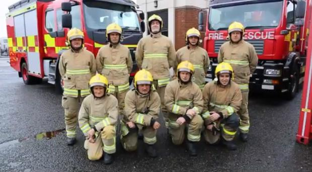 Northern Ireland firefighters during their fire safety video. Credit: NIFRS