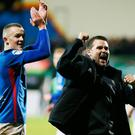 Big night: Linfield boss David Healy and (left) striker Michael O'Connor celebrate their win over Glentoran at the Oval on Monday