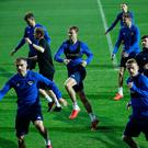 Northern Ireland's players warm up at the Grbavica Stadium, Sarajevo.