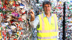 Byson director Eric Randall and at the firm's recycling depot in Belfast