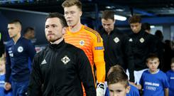 Corry Evans leads out Northern Ireland in Sarajevo.