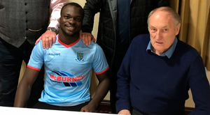 Sealing the deal: New Ballymena United signing Basit Umar (front centre) with United manager David Jeffrey (back left), assistant manager Bryan McLoughlin (back right) and chairman John Taggart (front right)