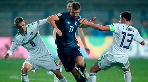 Dzek mate: Bosnia striker Edin Dzeko takes on Steven Davis and Corry Evans