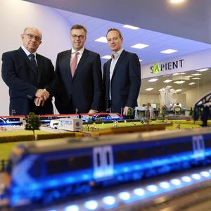 John Cunningham, CEO of Camlin, left, and Peter Cunningham, Sales Director, right, with Alastair Hamilton, Invest NI. Photo by Kelvin Boyes / Press Eye.