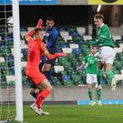 Northern Ireland's Mark Sykes scores to put his side 1-0 up at Windsor Park.