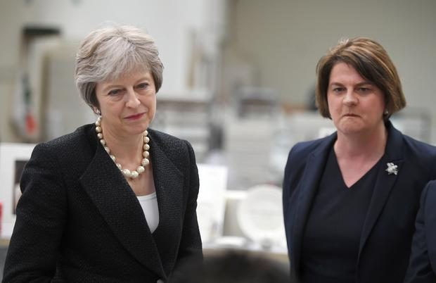 Prime Minister Theresa May (left) and Arlene Foster. (Clodagh Kilcoyne/AP)