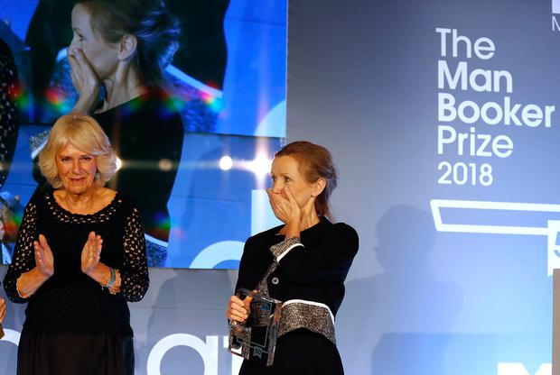 The Duchess of Cornwall (left) and Anna Burns on stage at the Guildhall in London after she was awarded the Man Booker Prize for Fiction for her novel Milkman. PRESS ASSOCIATION Photo. Picture date: Tuesday October 16, 2018. See PA story SHOWBIZ Booker. Photo credit should read: Frank Augstein/PA Wire