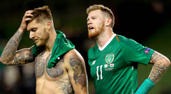 Sinking feeling: Republic duo James McClean (right) and Jeff Hendrick at the end of last night's match in Dublin