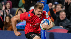 Running man: Ulster's Jacob Stockdale races over to score his try against Leicester
