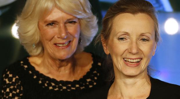 The Duchess of Cornwall (left) presents the Man Booker Prize for Fiction to Anna Burns (Frank Augstein/PA)