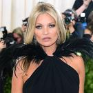 Kate Moss has given a copy of her book (Ian West/PA)