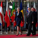 Britain's Prime Minister Theresa May arrives accompanied by British Ambassador to the EU Tim Barrow (C) at the European Council in Brussels on October 17, 2018.