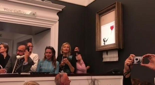 The moment when Girl With Balloon shredded itself after being sold for more than £1 million at a Sotheby's auction (Banksy/PA)