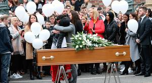 Family and friends during the funeral of Mairead O'Neill at St Malachy's Church, Belfast