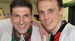 Glory days: Paul Leeman and Michael Halliday with the Gibson Cup in 2009