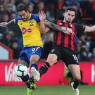 Southampton's Danny Ings (left) and Bournemouth's Lewis Cook battle for the ball during Saturday's goalless draw at the Vitality Stadium (Mark Kerton/PA)