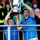 Just champion: Coalisland's Stephen McNally lifts the O'Neill Cup with Shane Corr