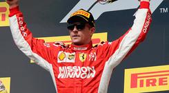 Red alert: Kimi Raikkonen celebrates his win