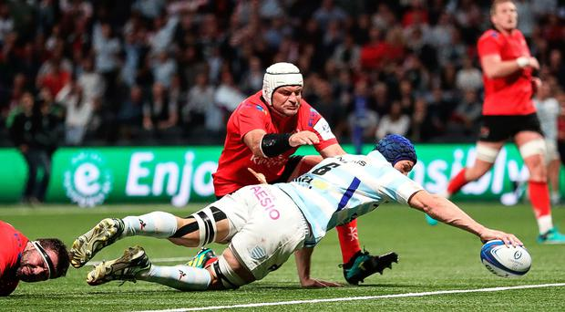 Going over: Wenceslas Lauret scores his side's second try against Ulster as Rory Best makes a last ditch tackle