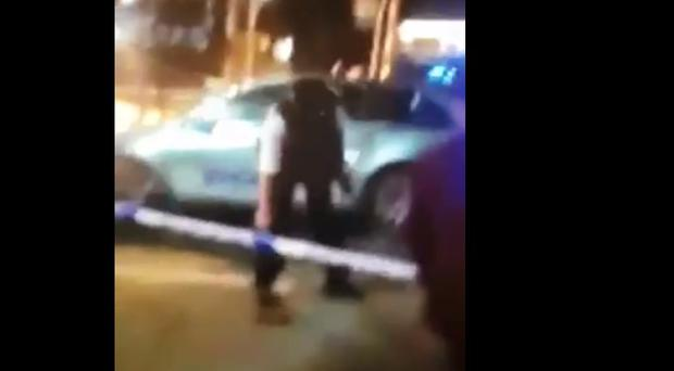 In a video circulating on social media, the officer can be seen picking up something from the ground.
