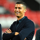 Old haunt: Juventus ace Cristiano Ronaldo is all smiles, in spite of rape allegation, during a walkabout at former ground Old Trafford last night
